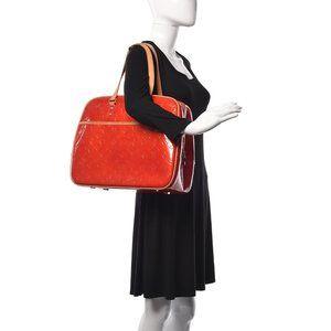 Authentic Louis Vuitton Sutton vernis red